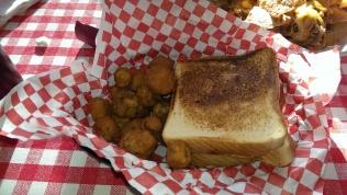 Brisket sandwich with a side of fried okra.