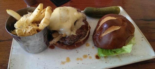 Burger on pretzel bun with parmesan fries.
