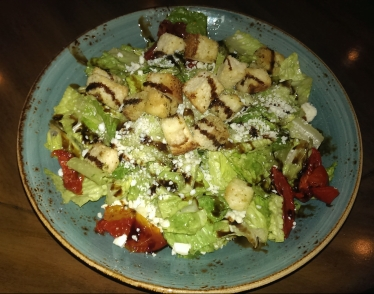 Caesar salad with roasted peppers